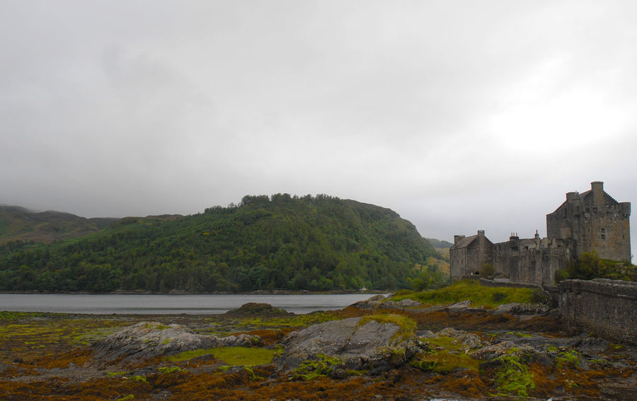 A bleak day at Eilean Donan Castle, Kyle of Lochalsh. (corrected version) Bridge Building Exterior Clouds Cloudy Day Day Eilean Donan Castle No People Outdoors Rocks Scenic View Scotland Travel Destinations Water