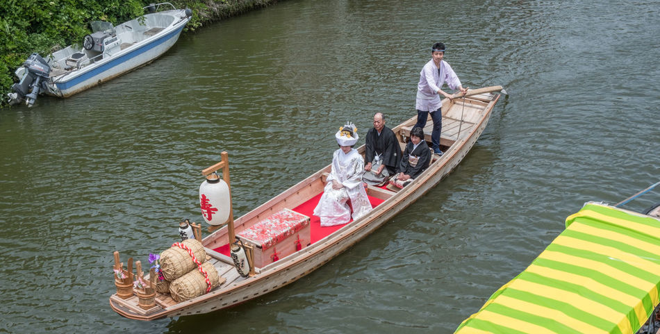 The Bridal Boat or Yomeiribune, a Japanese bride boarding a wooden boat in traditional costume during the annual Suigo Itako Iris Flower Festival. Boat Boat Ride Boatman Bridal Bride Canal Ceremony Culture Custom Day Girl Itako Japanese  Joyous Men Occasion Traditional Transport Water Waterway Woman Wooden Yomeiribune