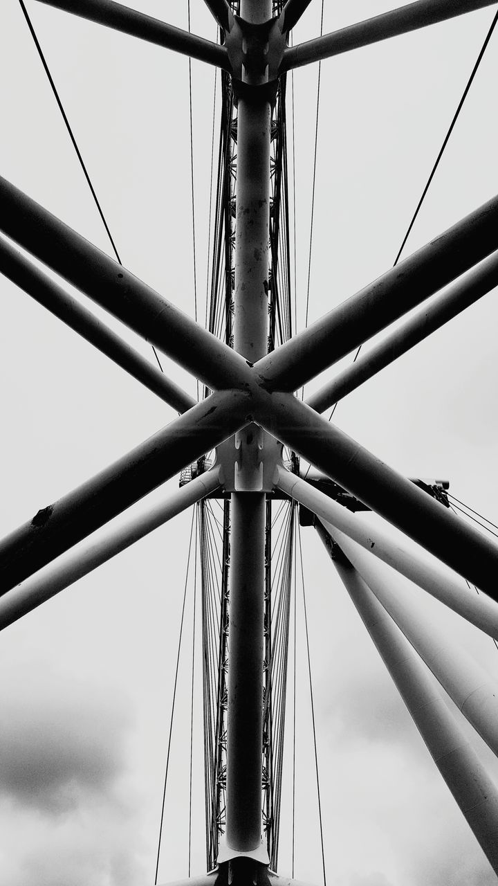 sky, low angle view, metal, no people, day, connection, built structure, nature, architecture, outdoors, transportation, rope, bridge, pole, bridge - man made structure, strength, cloud - sky, amusement park, cable, sailboat, directly below, power supply