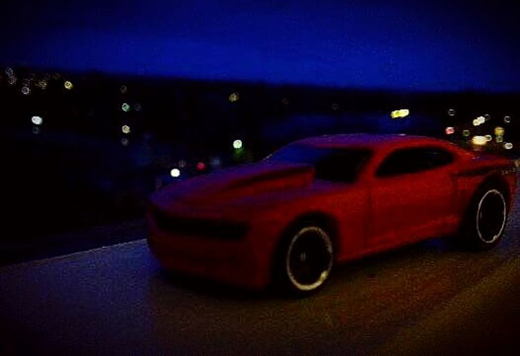Transportation Car Illuminated Mode Of Transport Night Land Vehicle Road Street Dusk Tail Light Headlight Traffic Side View Red Vehicle City Life Vehicle Light Journey Outdoors No People Mustang Town ToyCar Red