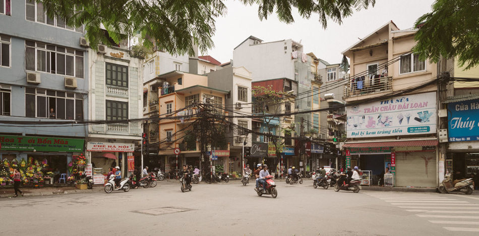 Square in Ha Noi, Vietnam Advertisement Architecture Building Building Exterior Built Structure City Day Human Body Part Large Group Of People Men Outdoors People Real People Road Scooter Scooters Sky Street Street Art Street Fashion Street Light Streetphotography Tree Women Yellow