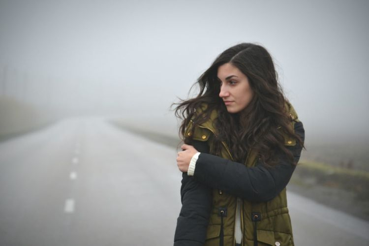 Weather Storm One Person People Cold Temperature Winter Fog Outdoors Adult Young Adult Only Women One Young Woman Only Day Portrait One Woman Only Young Women Adults Only Sky