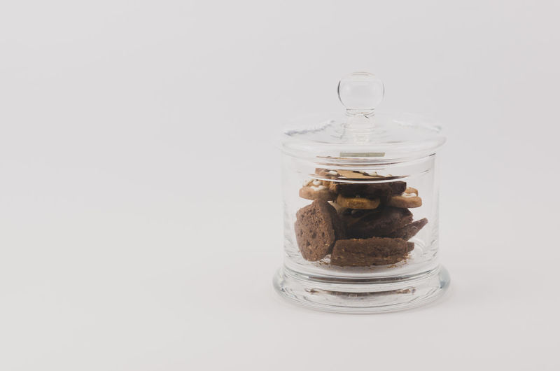 cookies in a glass jar Studio Shot White Background Food And Drink Glass - Material Indoors  Container Jar Food Still Life Transparent No People Copy Space Freshness Table Close-up Sweet Food Indulgence Sweet Nut Cookie Temptation