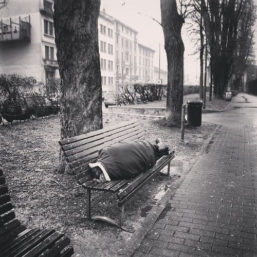 man sleeping on a bench under the rain Weekend Sad Cold Rain Rainy Day Blackandwhite B &w Saturday Loneliness Poor  Bench Clochard Milan Sadness Sleep Sleeping