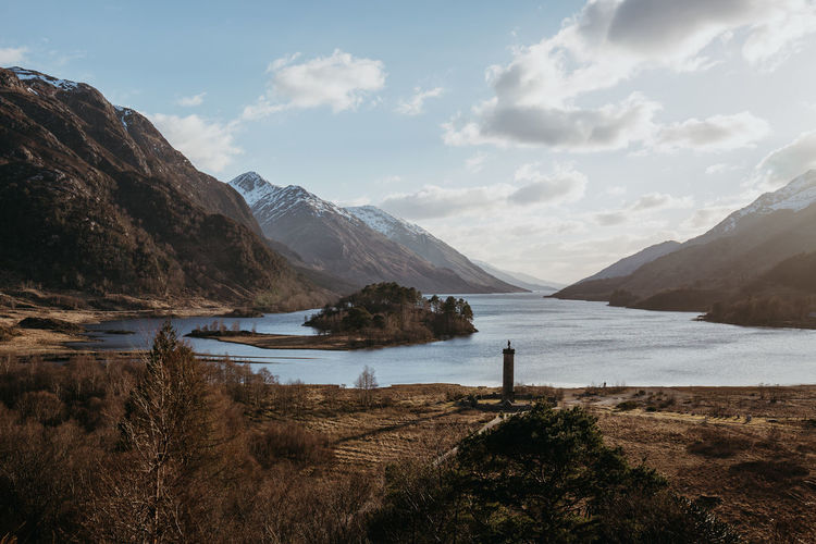 Glenfinnan Monument Loch  Loch Shiel Scotland Traveling Beauty In Nature Day Get Away Glenfinnan Lake Landscape Mountain Nature No People Outdoors Relaxing Moments Scenery Scenics Scotlandsbeauty Scottish Highlands This Week On Eyeem Tranquil Scene Tranquility Travelphotography Water Go Higher