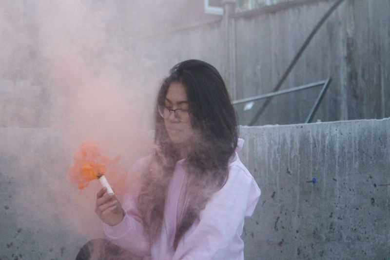 Smoke - Physical Structure Real People Waist Up Young Women Day One Person Lifestyles Leisure Activity Holding Young Adult Human Hand Construction Construction Site Smoke Bomb Vibrant Asian  Young Woman First Eyeem Photo
