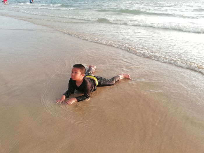 Children enjoy on summer trip 2019,หาดเจ้าหลาว Achi2019 Water Sea Beach Land One Person Leisure Activity High Angle View Real People Men Lifestyles Sand Nature Aquatic Sport Holiday Motion Day Trip Vacations Outdoors Boy