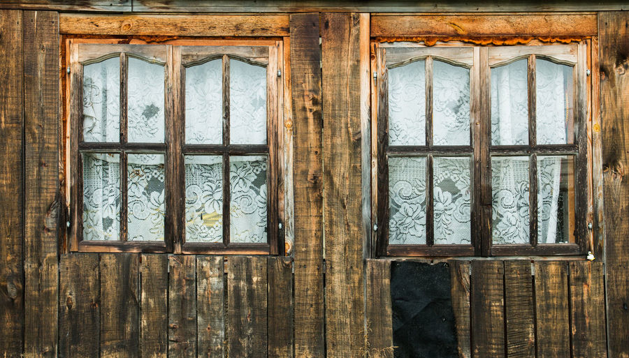 two wooden windows in an old wooden house Abandoned Architecture Broken Building Built Structure Damaged Day Full Frame Glass Glass - Material House Indoors  No People Old Reflection Transparent Weathered Window Window Frame Wood - Material