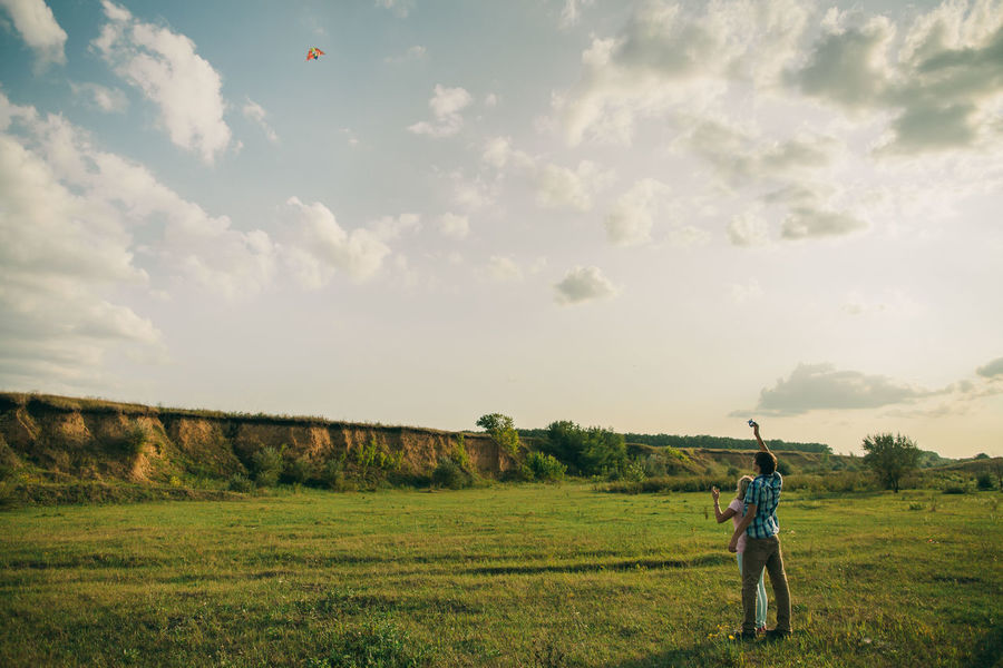 couple dating joyful with air kite. Love story couple at green meadow. Autumn Couple Dating EyeEm Best Shots EyeEmNewHere Field Happiness Love Nature Summertime Travel Air Kite Airkite Day Forest Girl Joy Of Life Joyful Moments Kite Flying Meadow Outdoors Picturesque Summer Teenager Tenderness