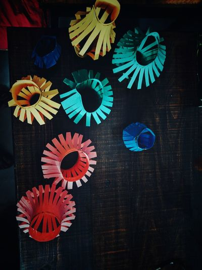 High angle view of multi colored umbrellas on paper