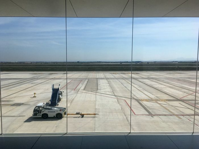 The wait for RyanAir EyeEm Selects Sky Transportation Day Mode Of Transportation Nature Sunlight Road Marking Outdoors No People Cloud - Sky Land Vehicle Travel Shadow Airport Technology City Architecture Built Structure My Best Photo