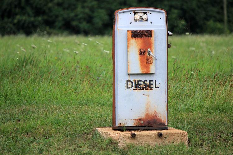 Abandoned fuel pump on grassy field