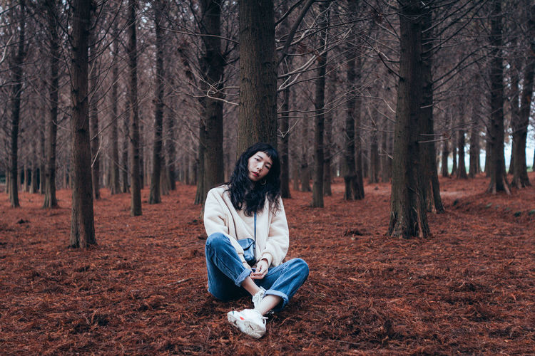 Tree Forest Land One Person Tree Trunk Sitting Plant Young Adult Nature Day Young Women WoodLand Long Hair Hair Hairstyle Outdoors Beautiful Woman Model Portrait