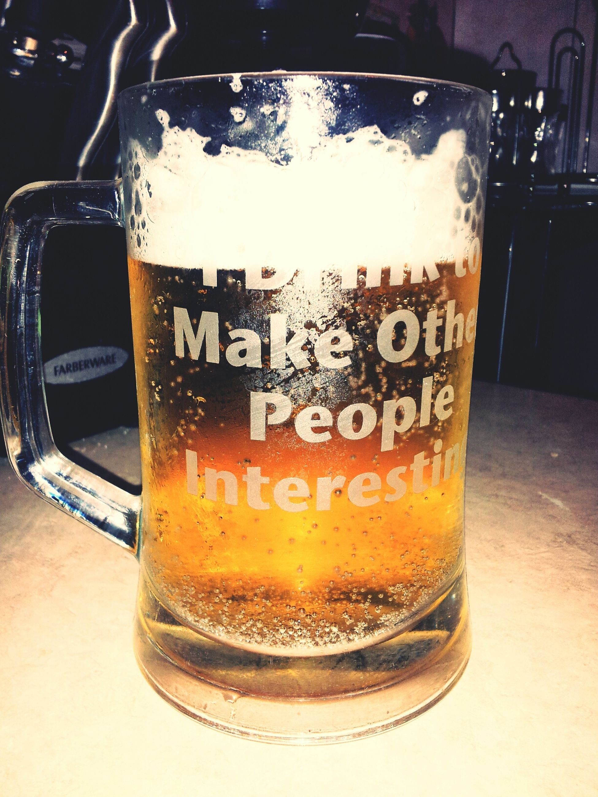 drink, indoors, food and drink, close-up, refreshment, text, glass - material, western script, drinking glass, still life, alcohol, communication, table, transparent, freshness, beer - alcohol, no people, frothy drink, focus on foreground, glass