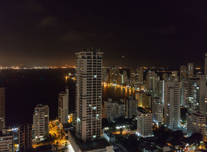 Night view of Cartagena Colombia Building Exterior City Illuminated Architecture Built Structure Night Building Office Building Exterior Cityscape Skyscraper City Life No People Modern Sky Residential District Nature Office Urban Skyline High Angle View Tall - High Nightlife Financial District