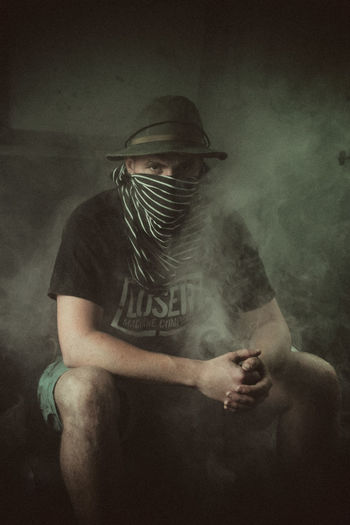 Portrait Of A.... EyeEmNewHere Looking At Camera Front View Holding Indoors  Lifestyles Men Obscured Face One Person Portrait Portrait Photography Real People Serious Smoke - Physical Structure Spooky Three Quarter Length The Photojournalist - 2018 EyeEm Awards The Portraitist - 2018 EyeEm Awards The Creative - 2018 EyeEm Awards
