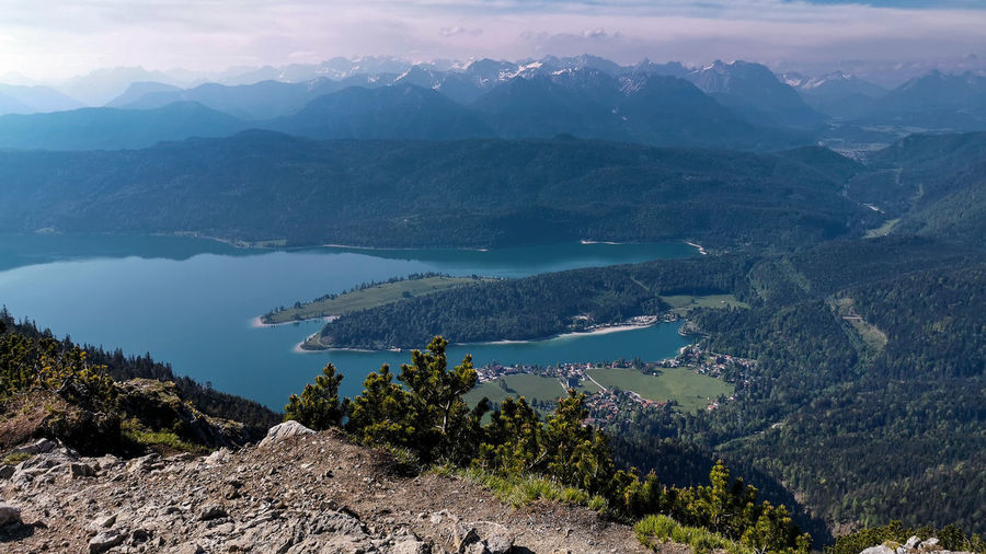 Scenic view from mountain martinskopf against lake walchensee, alps and sky