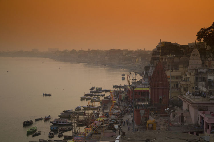 Sunset in Varanasi Clear Sky Ghat Hinduism India Orange Riverside Architecture Boats Buildings City Cityscape Clear Sky Day Ganga River Ghats Of Varanasi Nature Nautical Vessel No People Outdoors River Sky Sunrise Sunset Varanasi India Water
