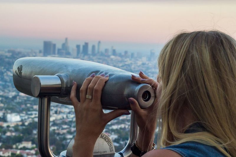 Coin-operated Binoculars Hand-held Telescope Leisure Activity Real People One Person Headshot Telescope Outdoors Water Day Focus On Foreground Sea Cityscape Close-up Women Architecture Photographing Sky City Building Exterior Los Angeles, California