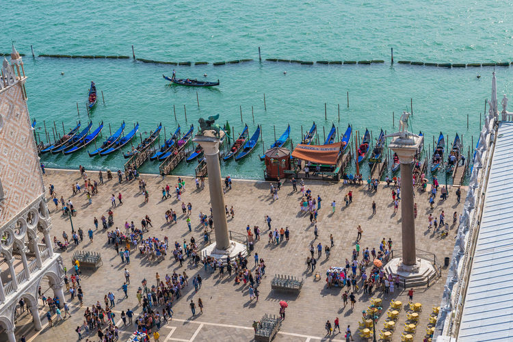 Aerial view of Venice and Grand Canal from St. Mark Campanile bell tower Adult Adults Only Aerial View Architecture Bell Tower City Life Cityscape Day Grand Canal High Angle View Italy Large Group Of People Outdoors People Real People St Mark Campanile Travel Destinations Venice Women