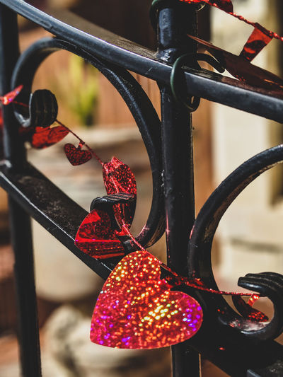 Close-up of illuminated decoration hanging on railing