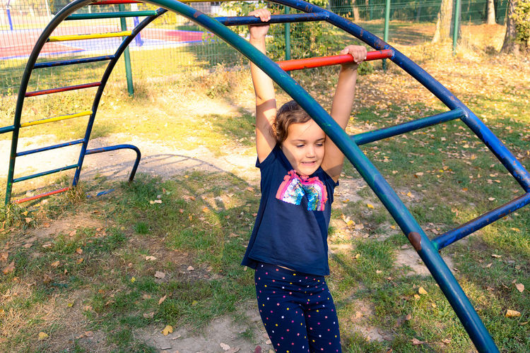 High angle view of girl playing in playground