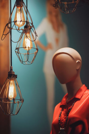 Close-up of illuminated pendant lights hanging in store