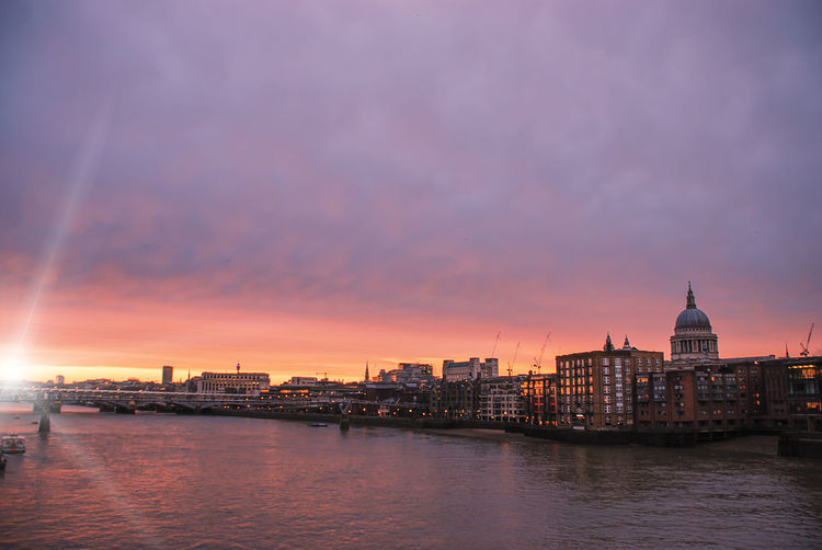 The iconic dome of st pauls cathedral on the london skyline at sunset
