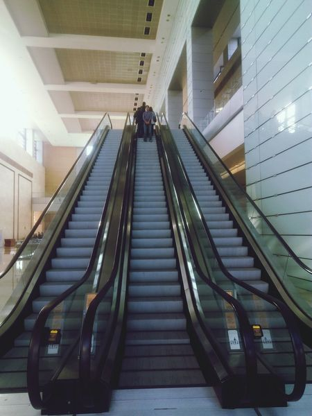 Railing Staircase Modern Two People Low Angle View Steps And Staircases The Way Forward Steps Escalator Architecture Built Structure Business City Business Finance And Industry Indoors