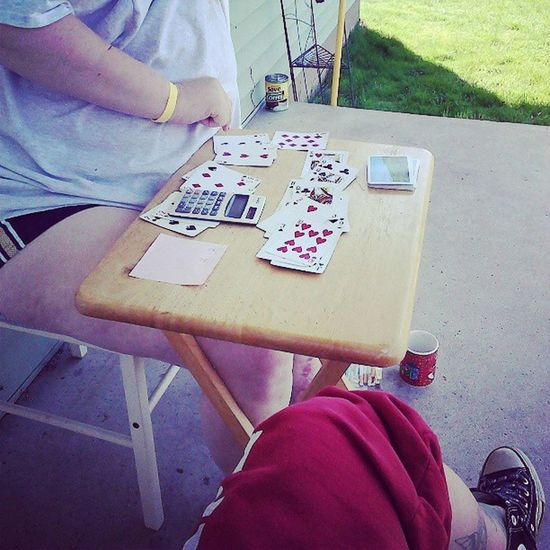 Playing Rummy with my client on this nice day and gettin paid :)