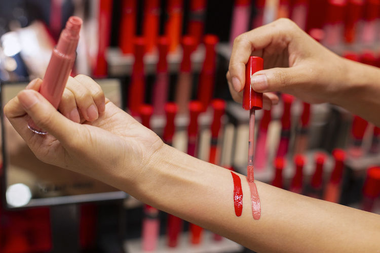 Girl testing Lipstick makeup samples on hand. Human Hand Hand Human Body Part Red Focus On Foreground Real People Close-up Lifestyles Women Finger Human Finger Body Part Holding Indoors  Adult Nail Polish Selective Focus Nail Human Limb Girl Testing Lipstick Makeup Sample Beauty Red Red Color Woman Trying Skin Red Lipstick