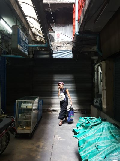 Full Length One Person Indoors  Day Phahurat Bangkok Shadow Shadows & Lights Talking Walking Woman Walking Woman Walking On The Street Streetphotography Streetphoto_color Street Life Mobile Conversations