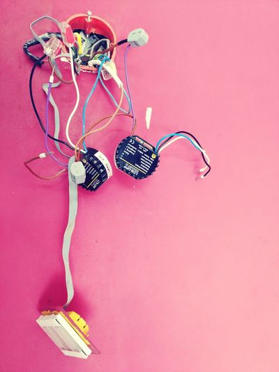 EyeEm Selects Intelligent home modules hanging on cables out of a pink painted wall No People Hanging Indoors  Close-up Day Electricity  Automation