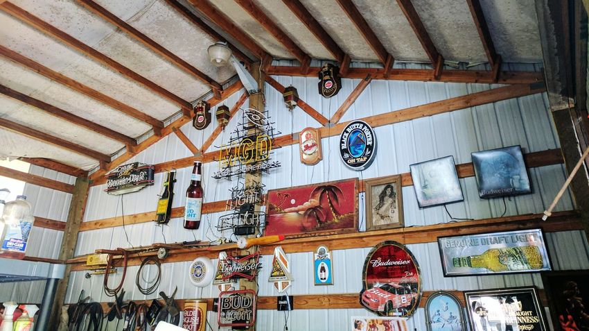 Man Cave Indoors  Ceiling Low Angle View No People Architecture Shop/garage Wall Art Beer Signs Day One Man's Passion Mechanic Shop Machine Shop