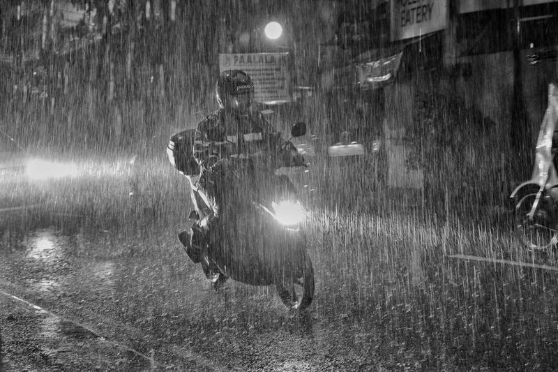 Storm & Bike Bike Motorcycle Biker Motorbike Delivery Transportation Bicycle Motorist Service Typhoon Rain Water Men Spraying Illuminated Wet Rainfall Monsoon Rainy Season Weather RainDrop Rain Torrential Rain