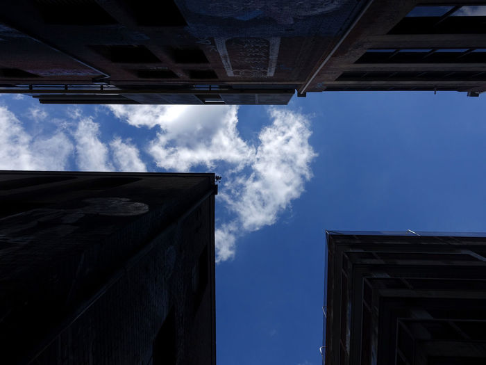 Architecture, look at the house from the bottom up Sky Architecture Built Structure Building Exterior Cloud - Sky Low Angle View Building Nature No People Blue Day Outdoors Directly Below Sunlight City Industry Window Factory Residential District Smoke - Physical Structure