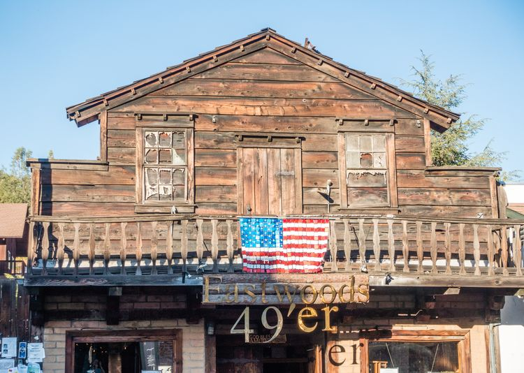 Built Structure Architecture Building Exterior Sky Day No People Flag Communication Text Building Nature Western Script Patriotism Wood - Material Outdoors Travel Destinations Old Clear Sky Mariposa