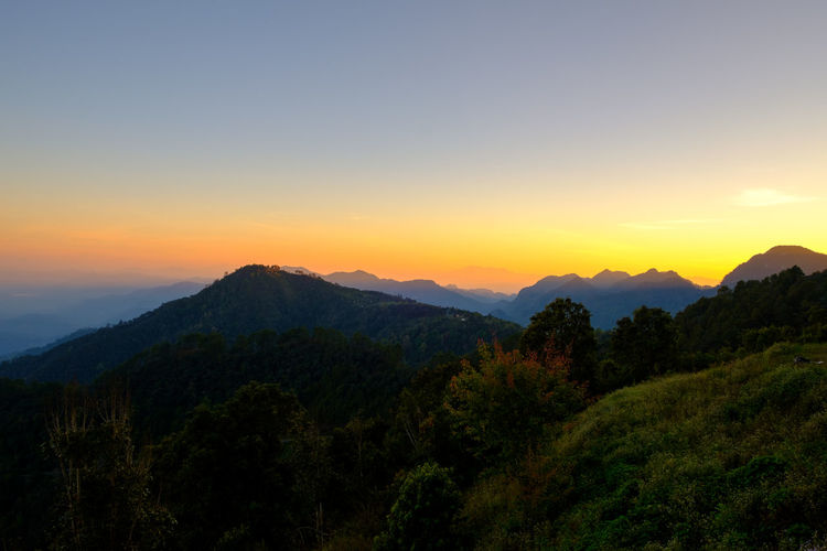 Sky Mountain Beauty In Nature Scenics - Nature Sunset Tranquility Tranquil Scene Tree Non-urban Scene Plant Idyllic Mountain Range Orange Color Environment Nature Landscape No People Copy Space Outdoors Cloud - Sky