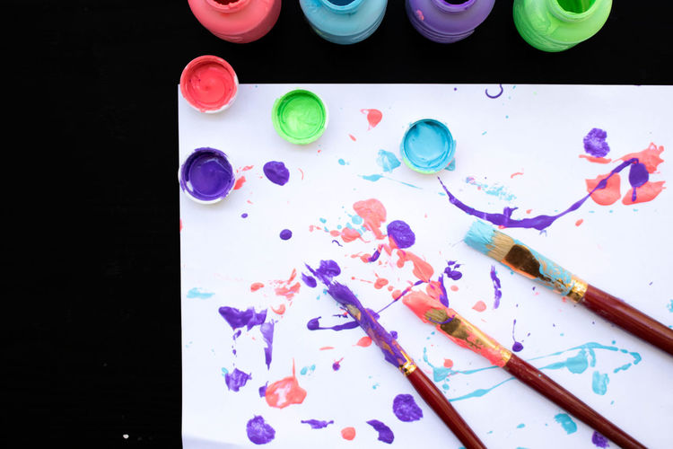 Art And Craft Art And Craft Equipment Black Background Brush Choice Close-up Craft Creativity High Angle View Indoors  Messy Multi Colored No People Paint Paintbrush Palette Paper Still Life Table Variation Watercolor Paints