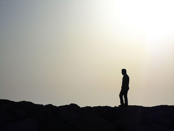 Alone Answer By The Sea Darkness And Light Highlights Light Light And Shadow Looking Into The Future No One Questions Silhouette Singing Solitary Song Sunset Thinking Walking Around Whisper