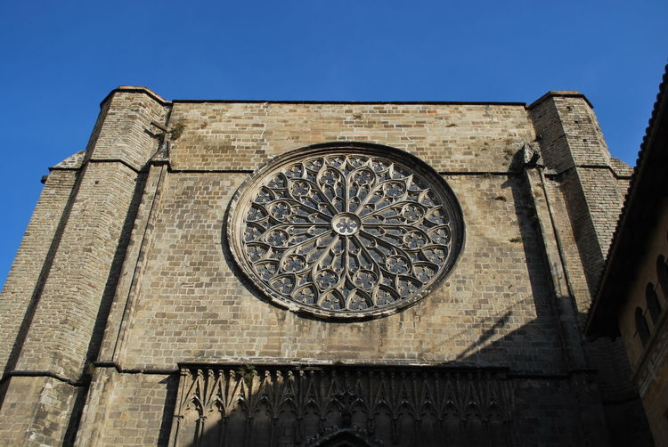 Architecture Astronomy Barcelona Barcelona, Spain Building Exterior Catalonia Catalunya Church Clock Day Low Angle View Medieval No People Old Buildings Old Town Outdoors Place Of Worship Religion Rose Window Sky SPAIN Time