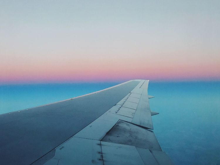 Airplane Transportation Sky Mode Of Transport Sunset Air Vehicle No People Outdoors Airplane Wing Travel Sea Water Nature Journey Aircraft Wing Flying Scenics Beauty In Nature Close-up Day Sunrise Delta Delta Airlines