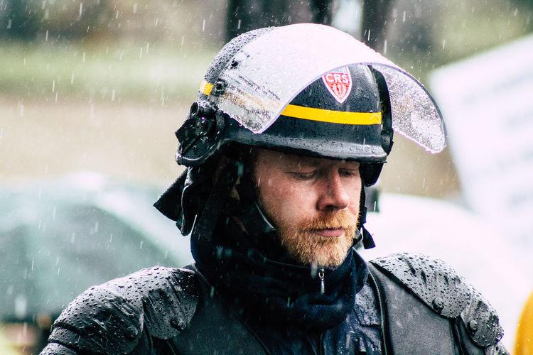 Portrait of man in snow during rainy season