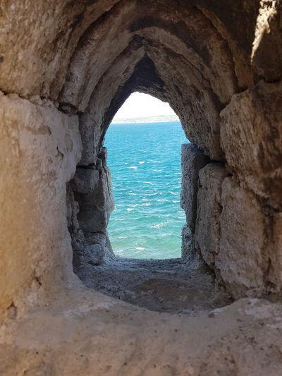 Sea seen through hole in rock
