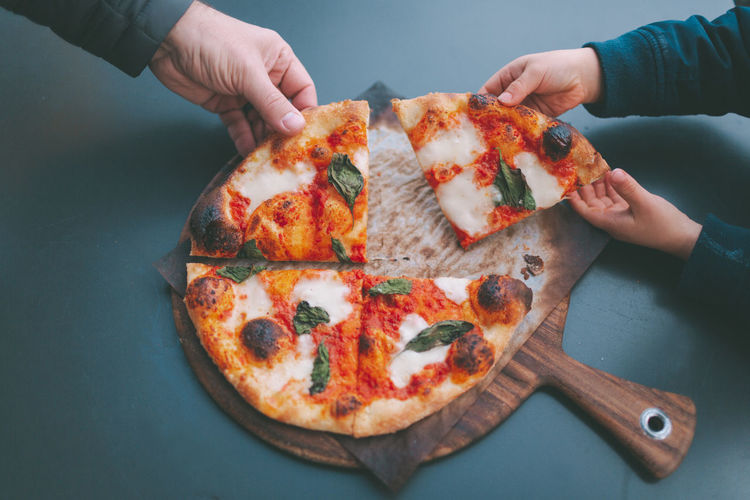 Hands reaching in to eat a Margherita pizza. Food Pizza Food And Drink Hand Human Hand Italian Food SLICE Table Reaching