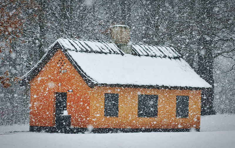 Snow covered house window of building