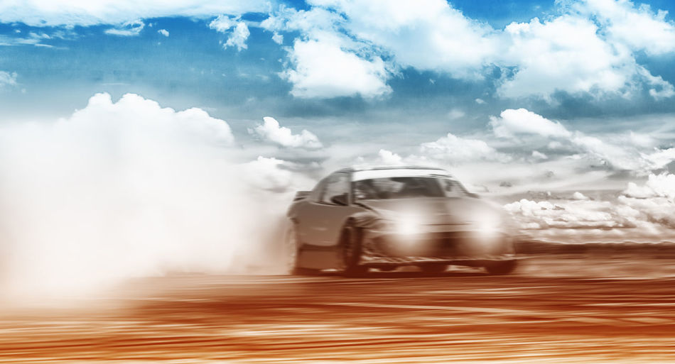 Blurred Speed Tracking Blurred Motion Car Cloud - Sky Day Driftting Driftwood Dust Land Vehicle Mode Of Transportation Motion Motor Vehicle Nature on the move Outdoors Road Sky Smoke - Physical Structure Speed Sports Clothing Sunlight Track Transportation Travel
