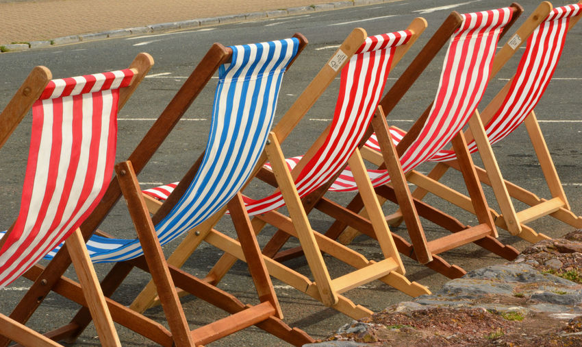 Deck Chairs On Road During Sunny Day