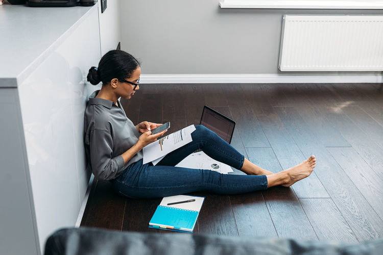 High angle view of woman working at home