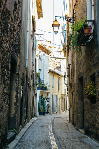 Narrow streets of the ancient town of Agde, southern France. Ancient Footpath France Paved Agde Alley Architecture Building Building Exterior Built Structure City Direction Electric Lamp House Lighting Equipment Long Medieval Narrow Old Outdoors Stone Street The Way Forward